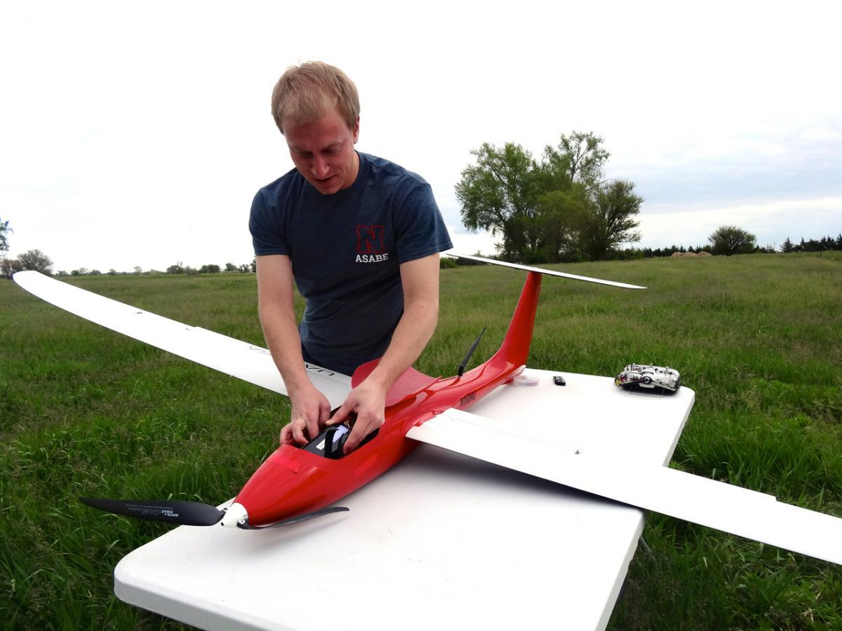 Mitch Maguire conducting a UAS preflight check