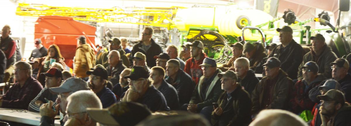 A group listening to a Soybean Expo Speaker