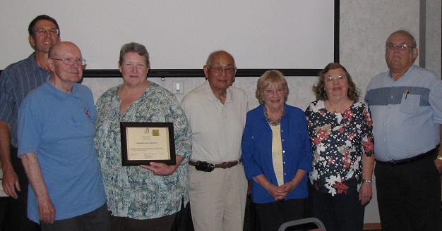 Representatives of the Monument Valley Iris Society receiving the SWCS Merit Award