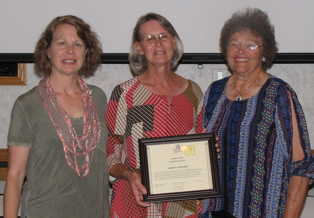 Shirley Ferguson (center) receives an SWCS Commentation Award