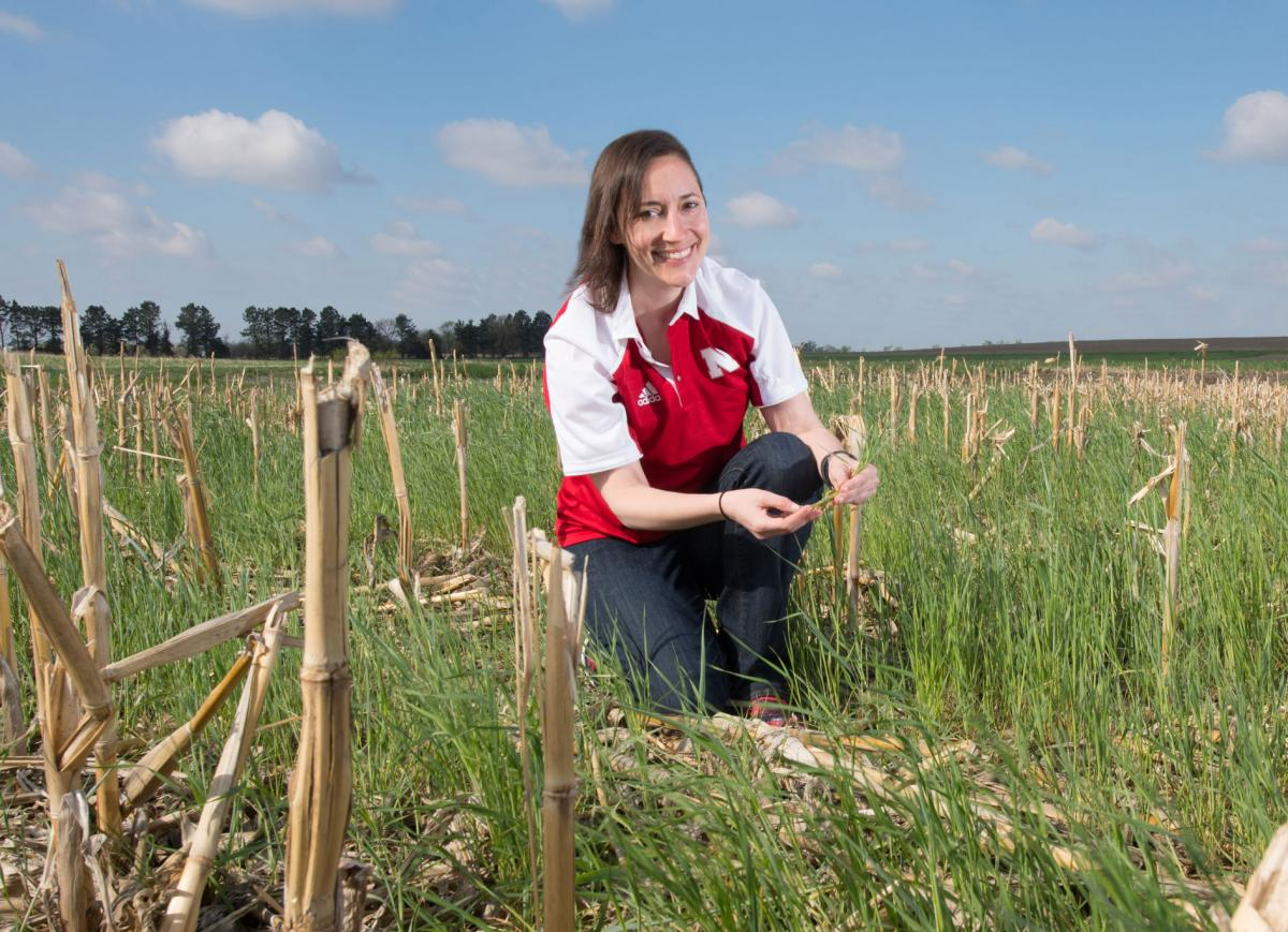 Andrea Basche in a corn-stubble cover crop field