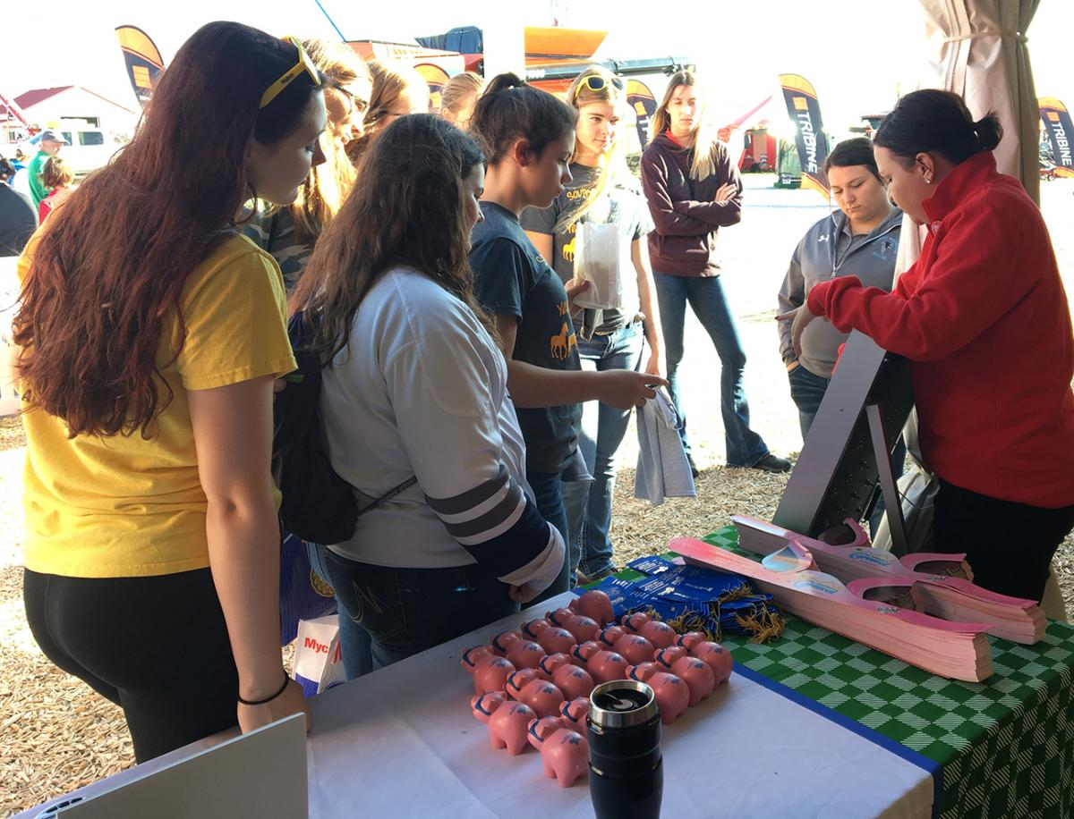 Nebraska Extension Educator talking with high school students at 2018 Husker Harvest Days