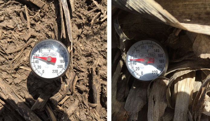 Two thermometers comparing soil temperature under bare soil and residue covered soil.