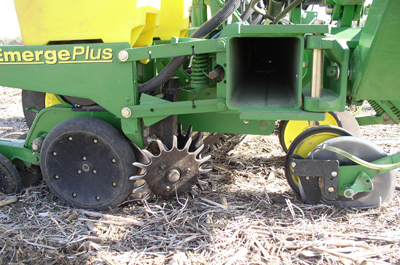 Photo of a no-till planter with heavy pressure springs