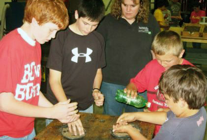 boys at youth program on crop science
