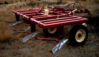 Four wide sweeps on a blade plow.