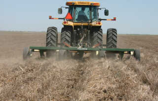 Blade plow operating in wheat stubble.