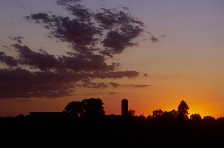 Sunset over a farmstead