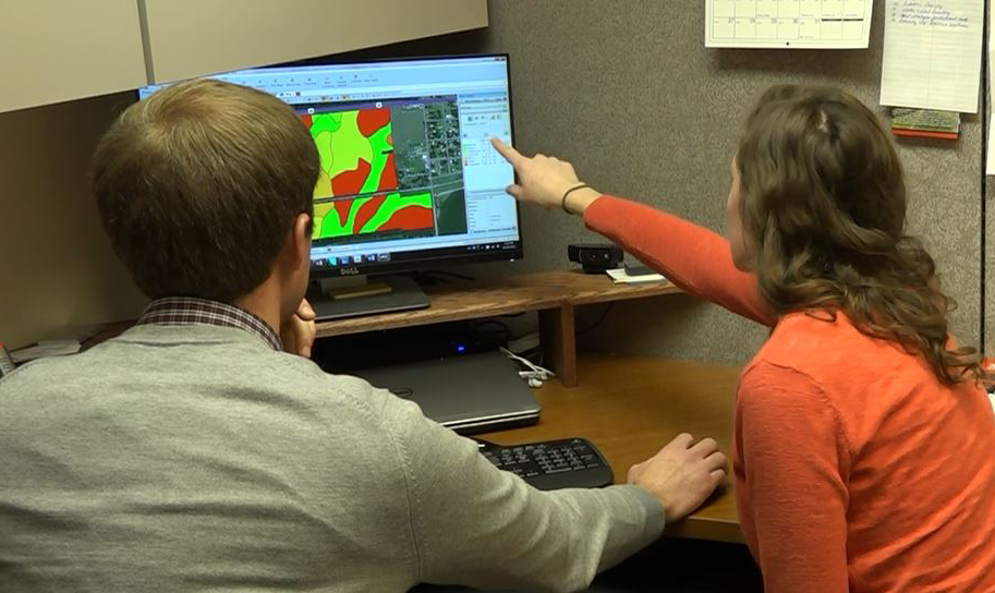 UNL researchers analyzing a data map on a computer screen