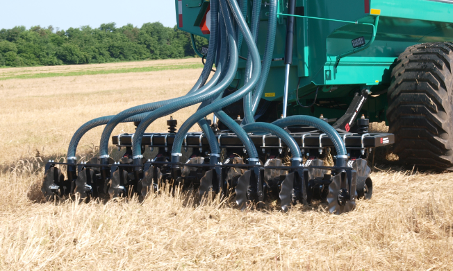 Manure being injected in wheat residue