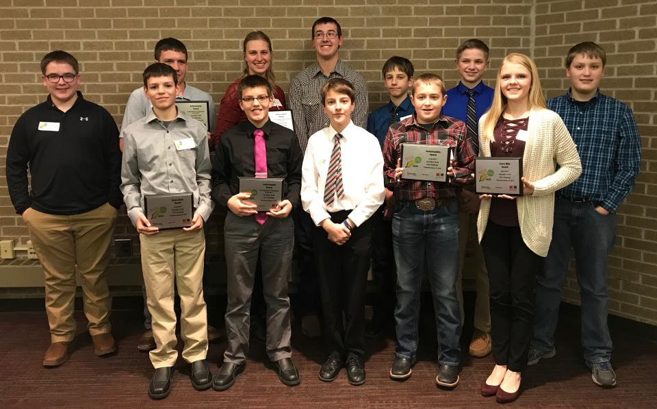 Figure 1. Youth attending the Innovative Youth Corn Challenge banquet were recognized for their efforts throughout the 2017 crop season to test corn production practices in science-based field trials. (Back Row L-R: Isaac Stromberg, Kade Stromberg, Juliana Loudon, Korbin Kudera, Hayden Beccard, Levi Schiller, James Rolf. Front Row L-R: Gavin Nelson, Rylan Nelson, Nolan Beccard, Landon Hasenkamp and Payton Schiller.) (Photos by Brandy VanDeWalle)