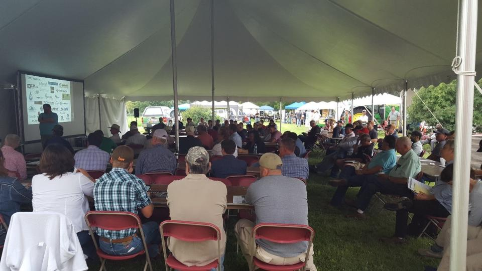Attendees under a tent at a previous Water and Crops Field Day