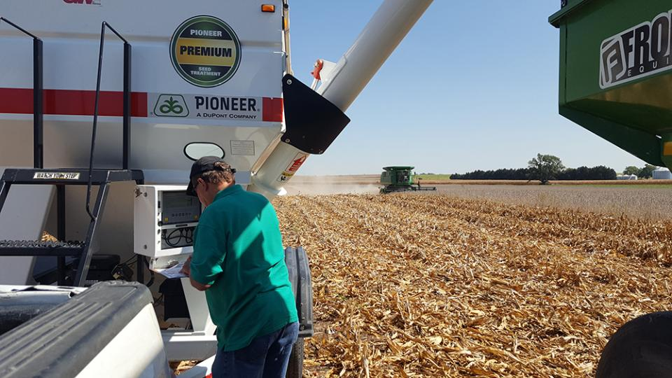 Figure 1. Extension Educator Gary Lesoing examines harvest data at one of the many on-farm research trials being conducted across the state. (Photo by Laura Thompson)