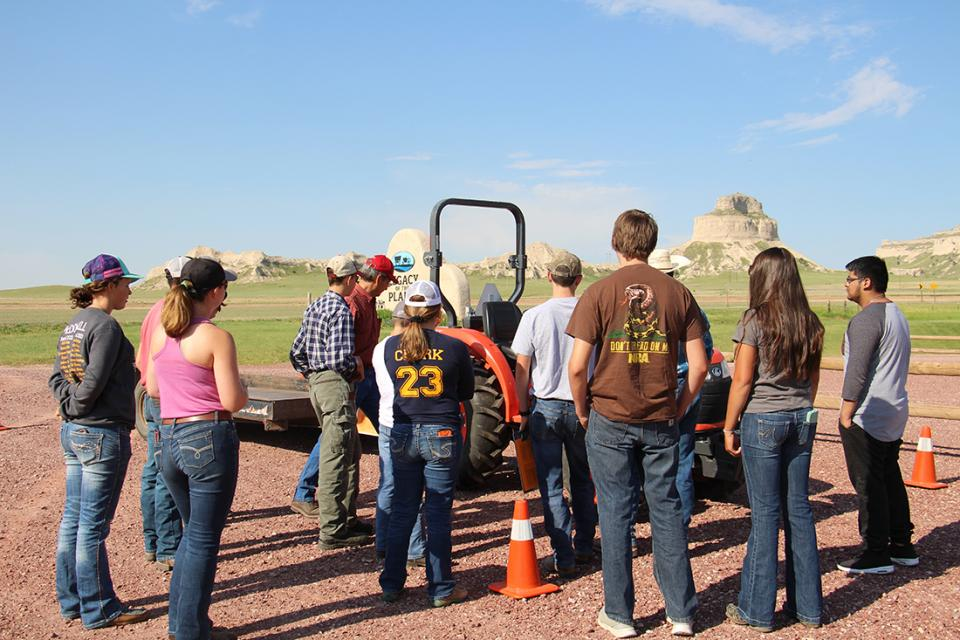 Youth watching a safety demonstration during Nebraska Extension's Tractor Safety and Hazardous Occupations Course at Gering in 2018.