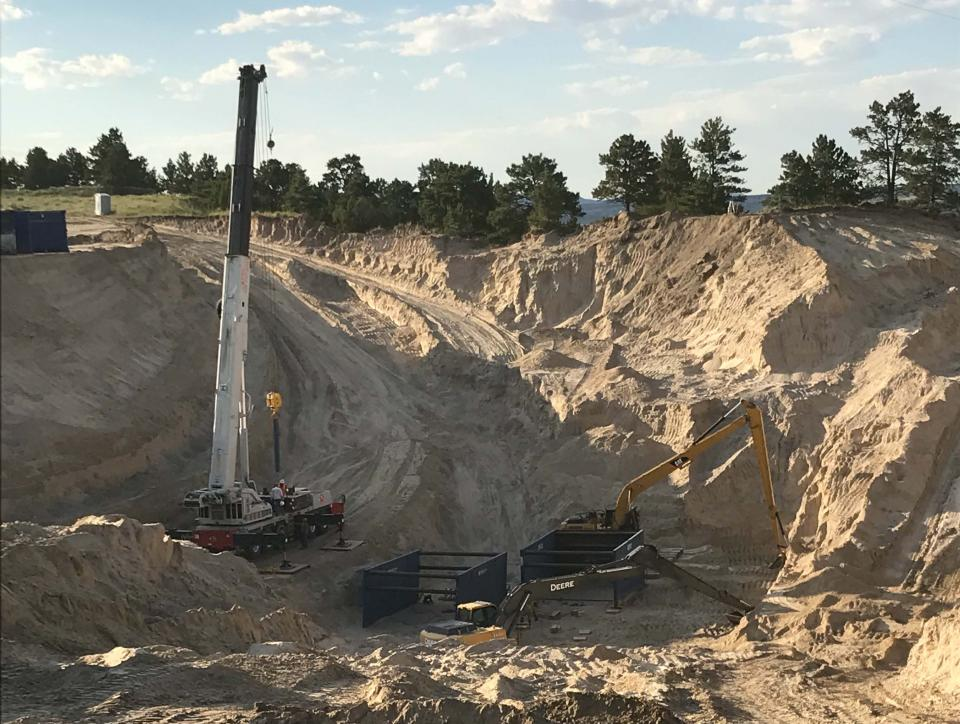 Excavation continues above the tunnel collapse. A series of three trench boxes, each 10 feet tall by 20 feet wide by 20 feet long will be dropped down into the space as soil is removed. (Photo courtesy the Goshen Irrigation District)