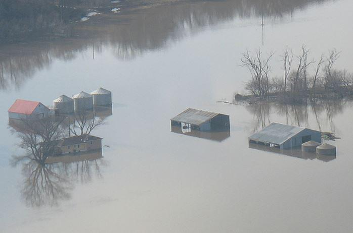 Aerial shot of grain bins in standing flood water