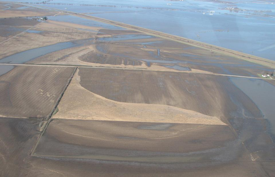 After flood waters recede, fields and farms have been left with layers of loose cornstalk debris that needs to be deposed of.