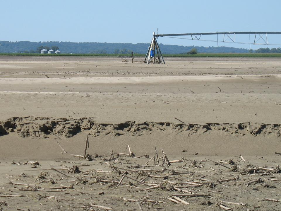 Sand-covered field with a center pivot