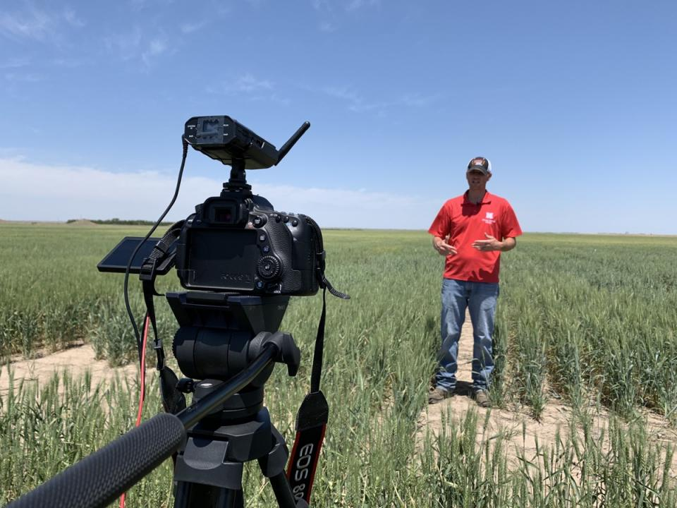 Cody Creech being recorded in a field