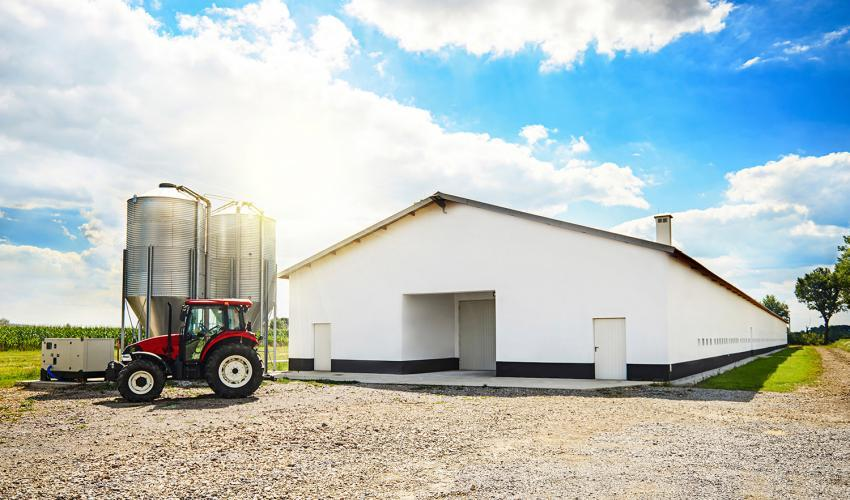 tractor in front of machine shed