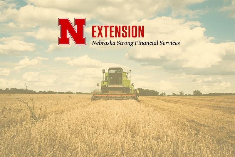 combine in a field with Nebraska Strong Financial Services logo