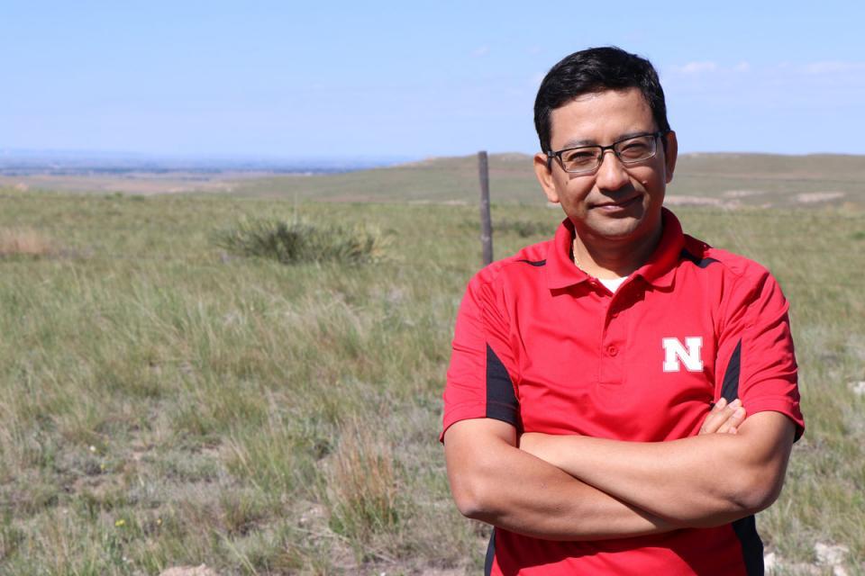 Dr. Bijesh Maharjan standing in a field