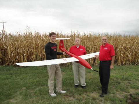 (From left) Matt Headrick, George Meyer and Wayne Woldt conduct a preflight check on an unmanned aircraft system.
