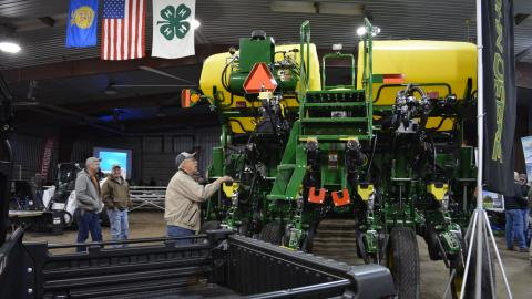 Grower examining a new sprayer at the Soybean Day and Machinery Expo