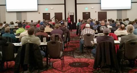 Extension Entomologist Julie Peterson speaking at an earlier Crop Production Clinic.