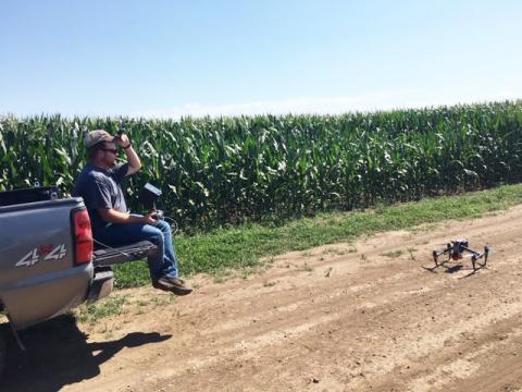 Nate Thompson prepares to launch a drone used in an NCR SARE-funded on-farm research project to assess using drone sensors for in-season nitrogen management. (Photo by Gary Lesoing)