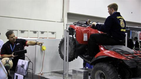 Figure 1. Aaron Yoder uses an ATV simulator at the National FFA Convention to provide safety training. Yoder will be one of the course instructors for the Youth Tractor Safety and Hazardous Occupations Course.