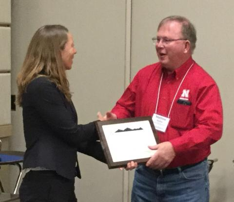 Matt Stockton accepting the Oustanding Extension Program award on behalf of the UNL-TAPS team.