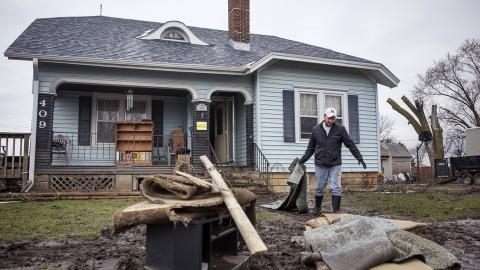 Connor Clark helps clear out the home of his grandfather, Dean Swim, in Winslow, Nebraska, on March 29, 2019.