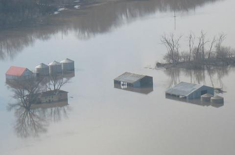 Flooded farmstead and grain bins