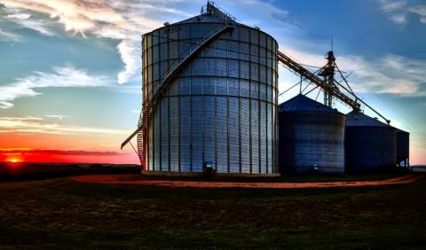 grain bins at sonset