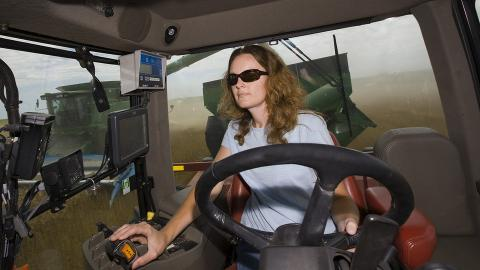 woman driving a tractor