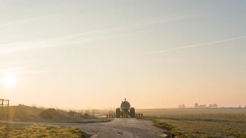 Tractor driving into the sunset
