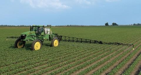 herbicide being applied to soybean field