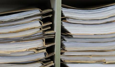 file folders on a shelf