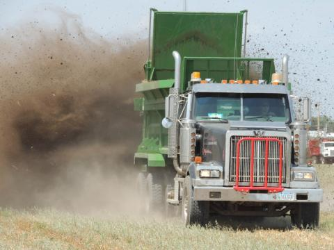 truck spreading manure