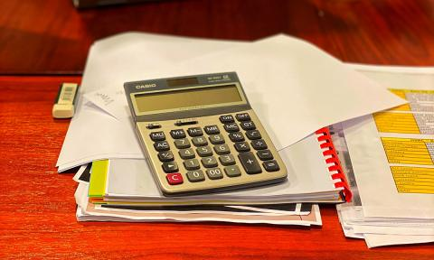 Calculator with financial papers