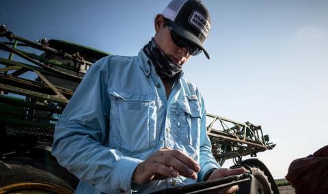 Farmer using online tool in field
