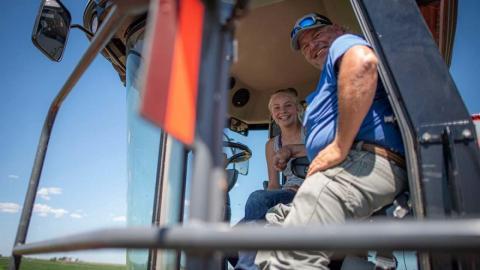 Farmers in tractor