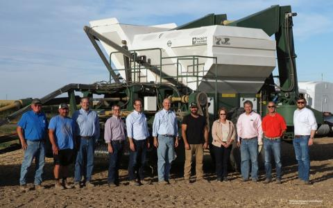photo of dignitaries visiting panhandle for dry bean harvest